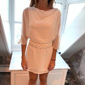 ARK & Co. white beaded open back dress.